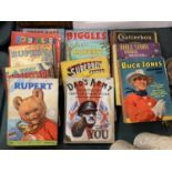 A COLLECTION OF VINTAGE ANNUALS TO INCLUDE RUPERT, SUPERBOY, BUCK JONES , BIGGLES ETC