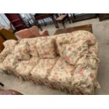 A MODERN FLORAL THREE SEATER SETTEE AND A MATCHING EASY CHAIR