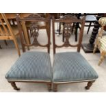 A PAIR OF EDWARDIAN LOW NURSING CHAIRS