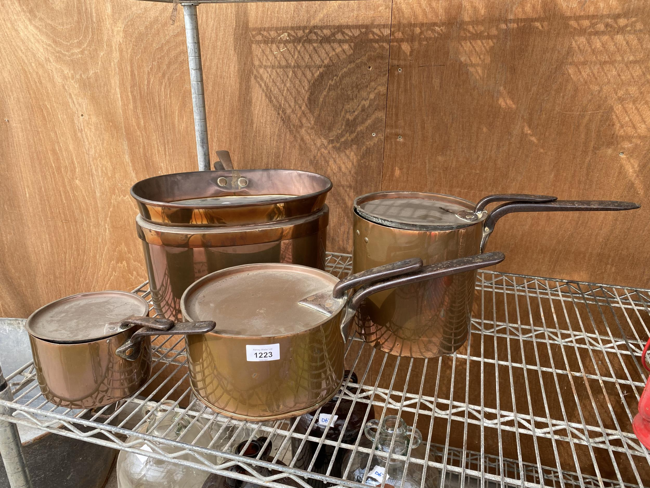 AN ASSORTMENT OF VINTAGE COPPER PANS IOF GARDUATED SIZES
