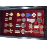 A GLAZED DISPLAY CASE CONTAINING SIXTEEN NAZI GERMANY MEDALS TO INCLUDE MOTHERS BADGE, IRON CROSS,