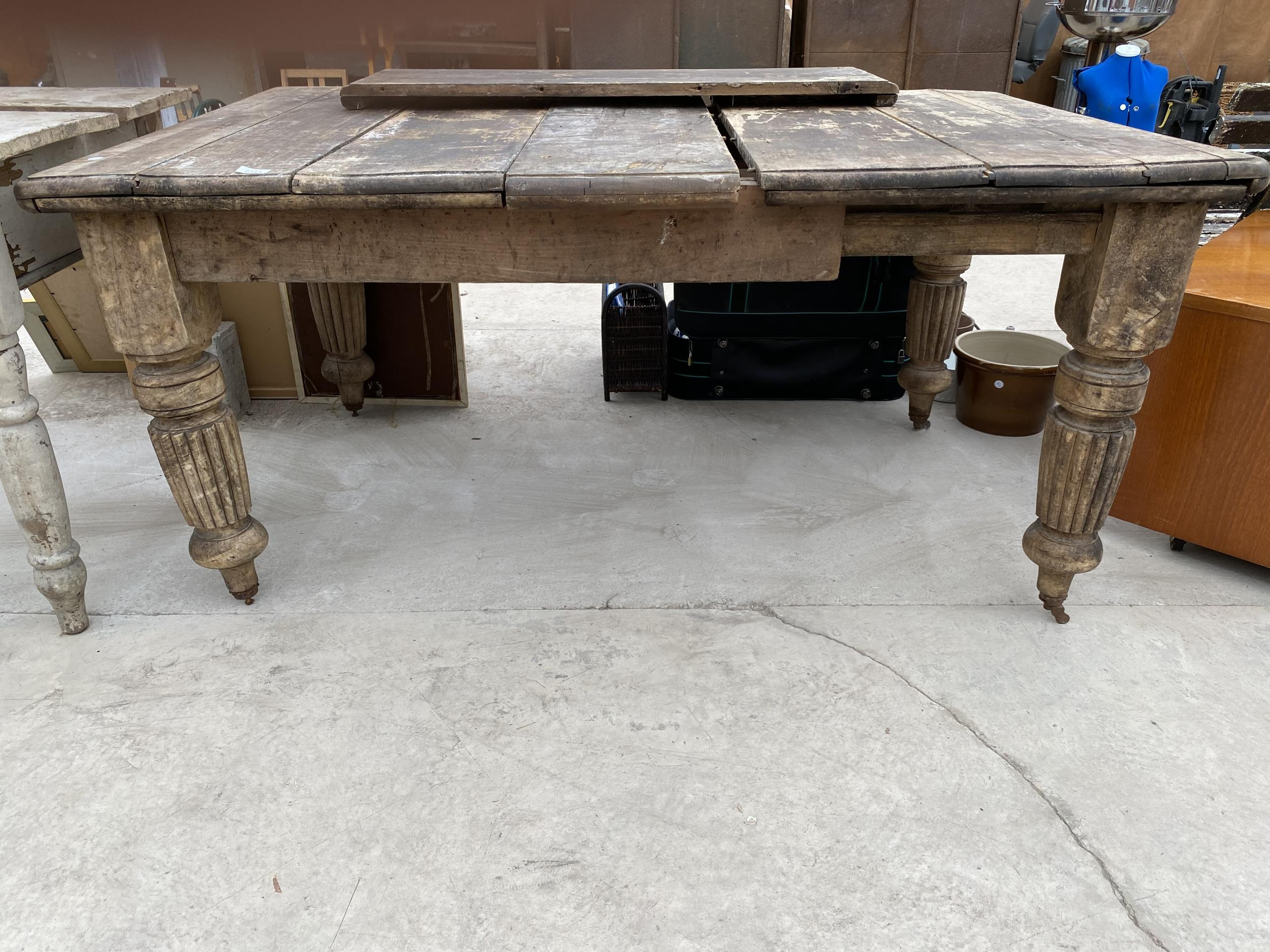 A VICTORIAN SCRUB-TOP WIND OUT DINING TABLE ON TURNED AND FLUTED LEGS - Image 2 of 4