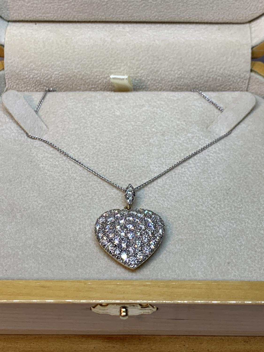 A 15 CARAT WHITE AND YELLOW GOLD LARGE DIAMOND ENCRUSTED HEART PENDANT WITH CHAIN LENGTH 44CM IN A
