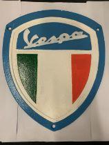 A CAST IRON 'VESPA' SIGN