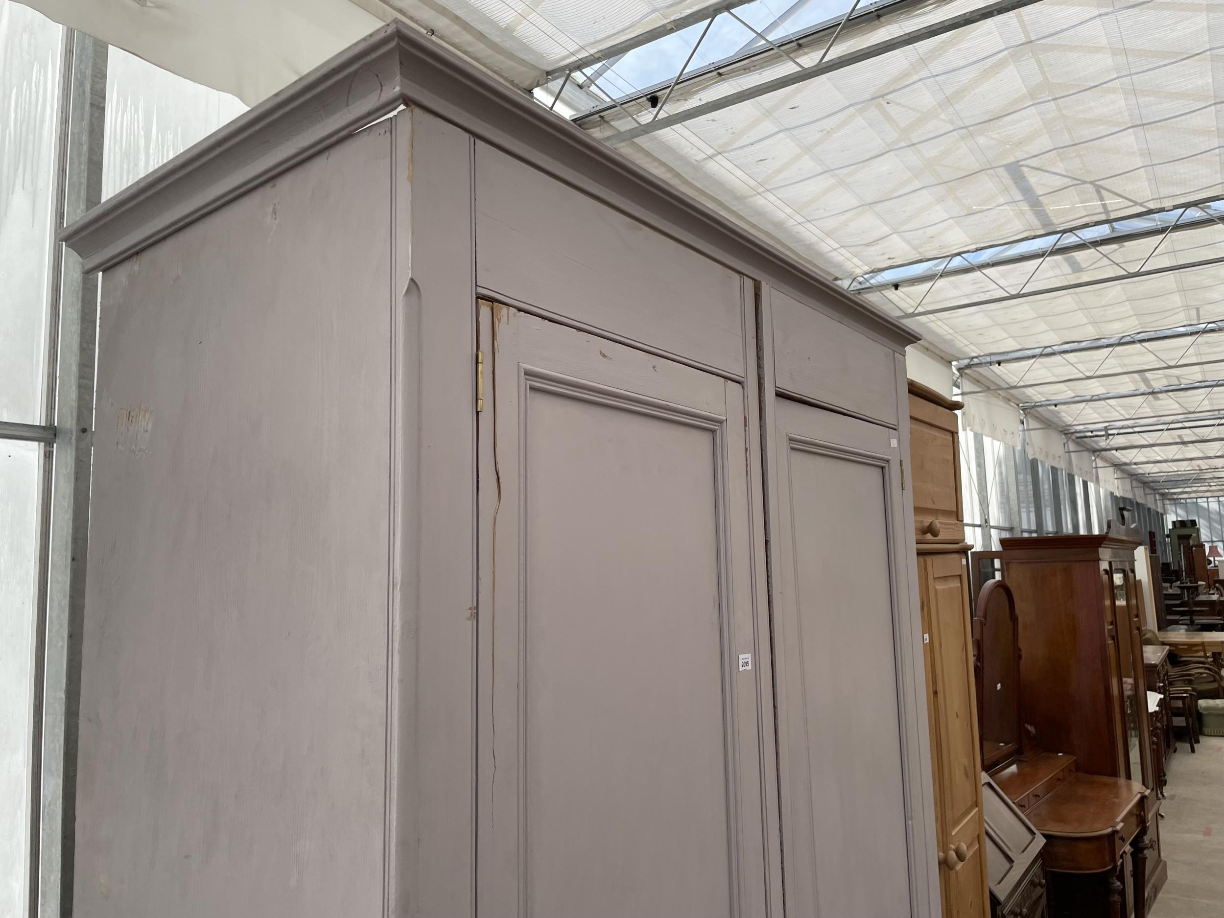 """A PAINTED PINE TWO DOOR WARDROBE WITH TWO DRAWERS TO THE BASE W:56.5"""" H:88"""" - Image 2 of 5"""