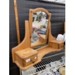 A DUCAL PINE DRESSING TABLE SWING MIRROR