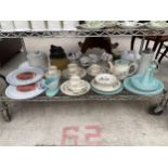 AN ASSORTMENT OF CERAMIC WARE TO INCLUDE PLATES, JUGS, AND TRIOS ETC