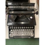 AN 'EVEREST' MADE IN ITALY VINTAGE PORTABLE TYPEWRITER MOD 90