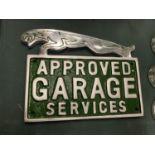 A CHROME JAGUAR GARAGE SERVICES SIGN