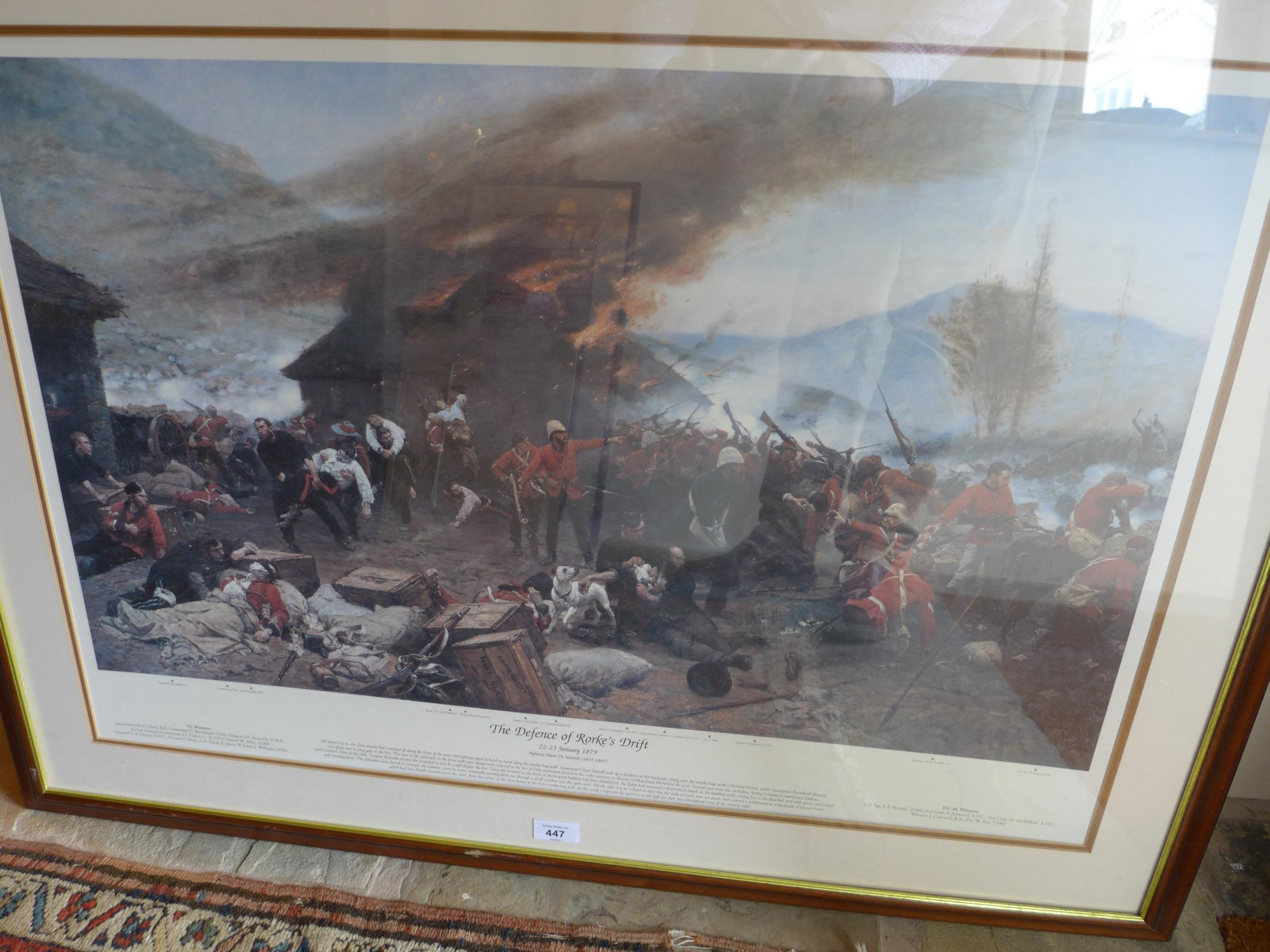 A LARGED FRAMED AND GLAZED COLOUR PRINT OF THE DEFENCE OF RORKE'S DRIFT, 22-23RD JANUARY 1879 WITH