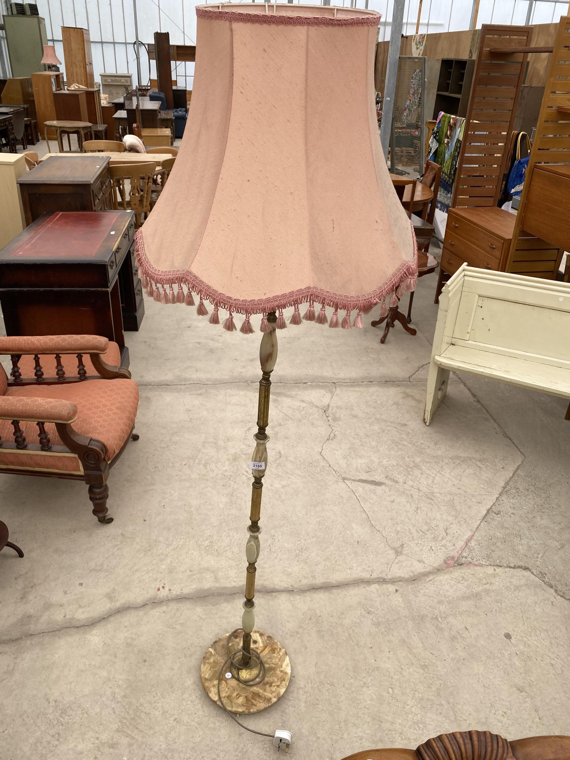 AN ONYX EFFECT STANDARD LAMP