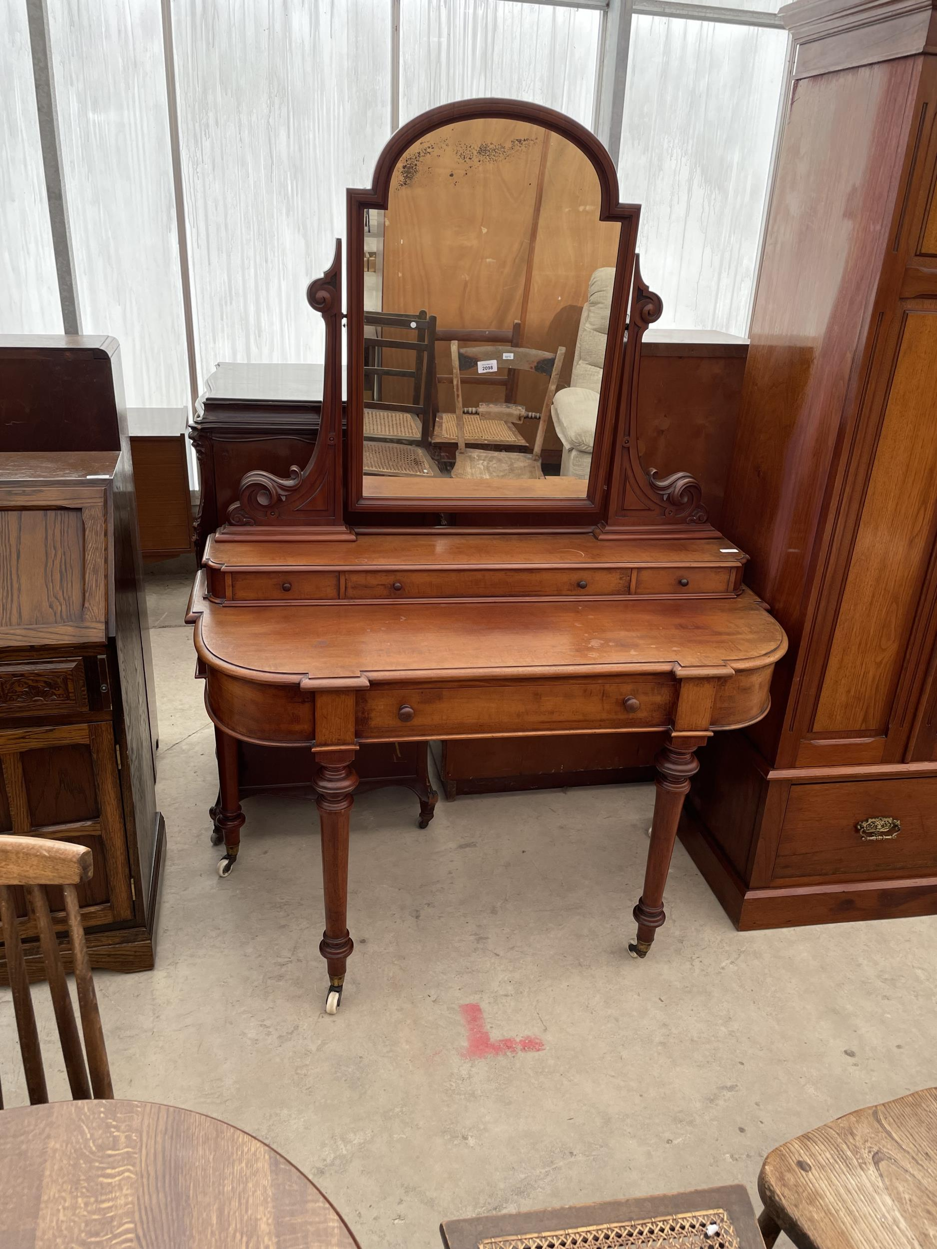 A VICTORIAN MAHOGANY DUCHESS DRESSING TABLE ON TURNED TAPERING LEGS WITH WHITE WIDE P+S PATENT