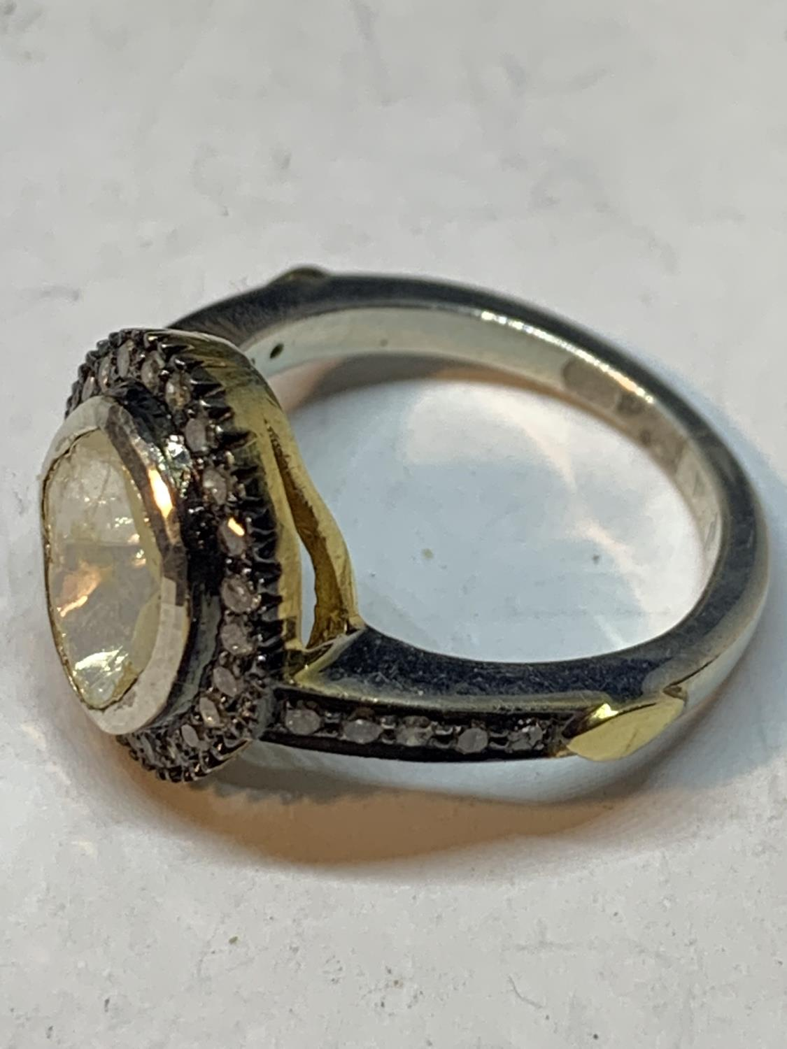 A CONTINENTAL WHITE AND YELLOW METAL RING WITH CENTRE DIAMOND AND SMALLER SURROUNDING DIAMONDS WHICH - Image 6 of 6