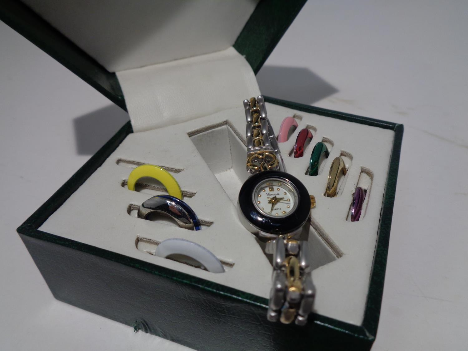 A VIMORA BOXED WATCH WITH COLOURED INTERCHANGEABLE WATCH FACE SURROUNDINGS - Image 4 of 6