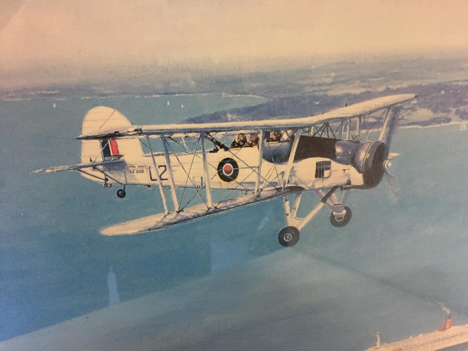 A FRAMED COLOURED PICTURE OF A SWORDFISH PLANE FLYING OVER A CRUISE SHIP 30CM X 40CM - Image 2 of 3