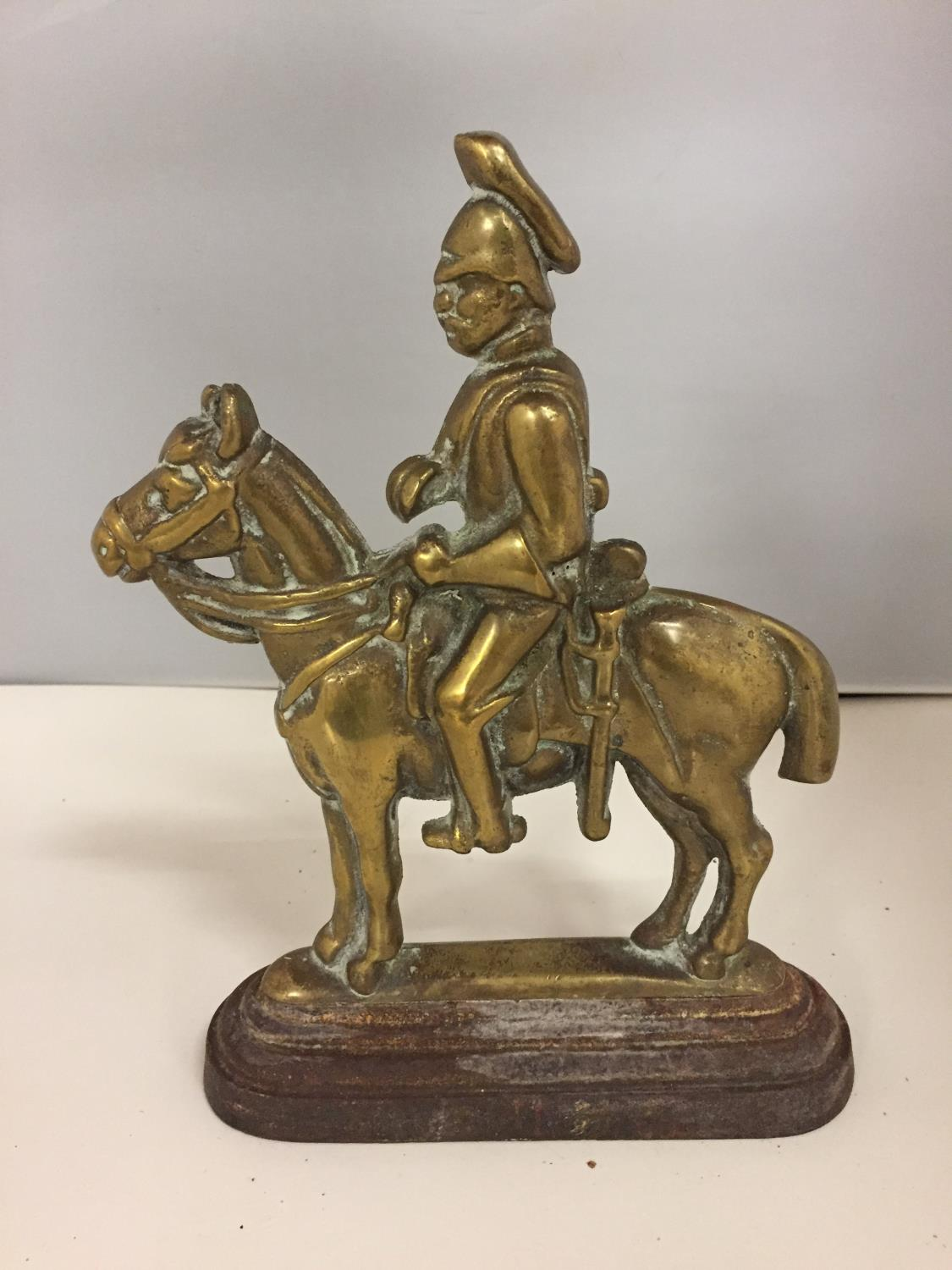 A CAST IRON BASE DOOR STOP WITH SOLDIER