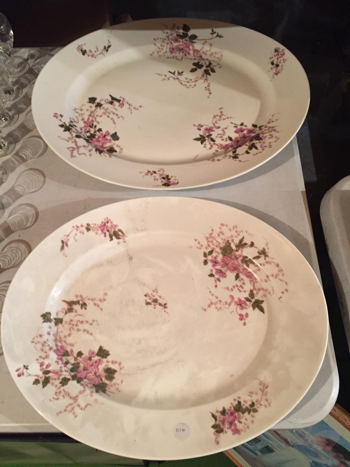 TWO LARGE HEAVY CERAMIC MEAT PLATTERS WITH A DELICATE PINK FLOWER DESIGN