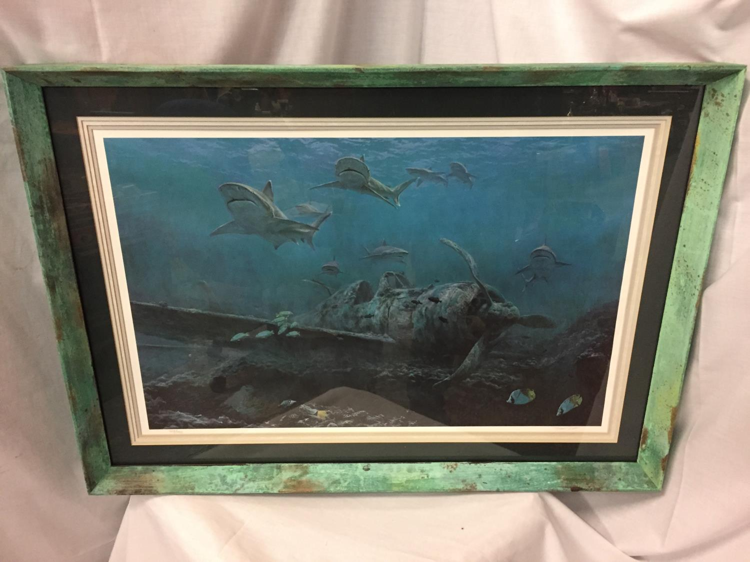 A FRAMED AND SIGNED LIMITED EDITION 528/750 COLOURED PRINT OF A WORLD WAR 11 SUBMERGED FIGHTER PLANE