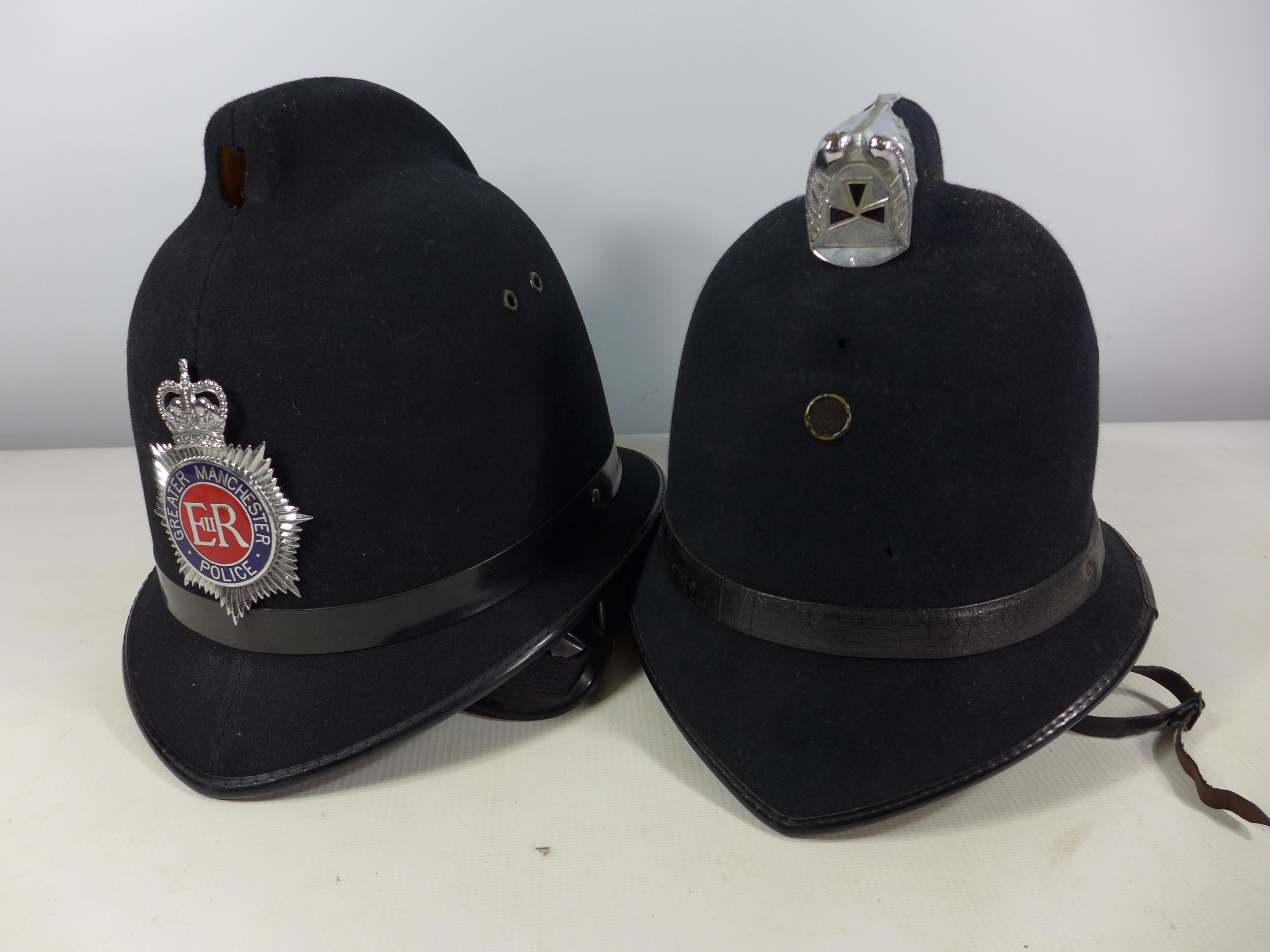 A GREATER MANCHESTER POLICE HELMET AND ANOTHER HELMET