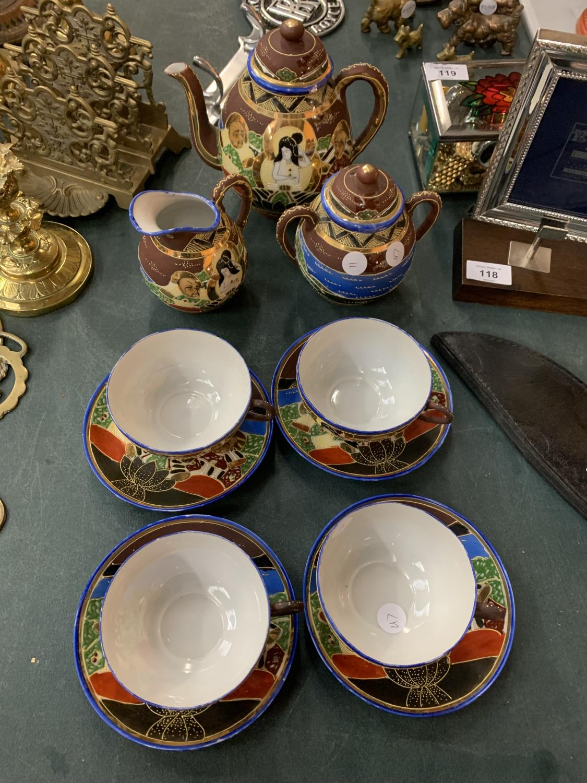 AN ORIENTAL SATSUMA TEA SET TO INCLUDE A TEAPOT, JUG, SUGAR BOWL AND FOUR CUPS AND SAUCERS