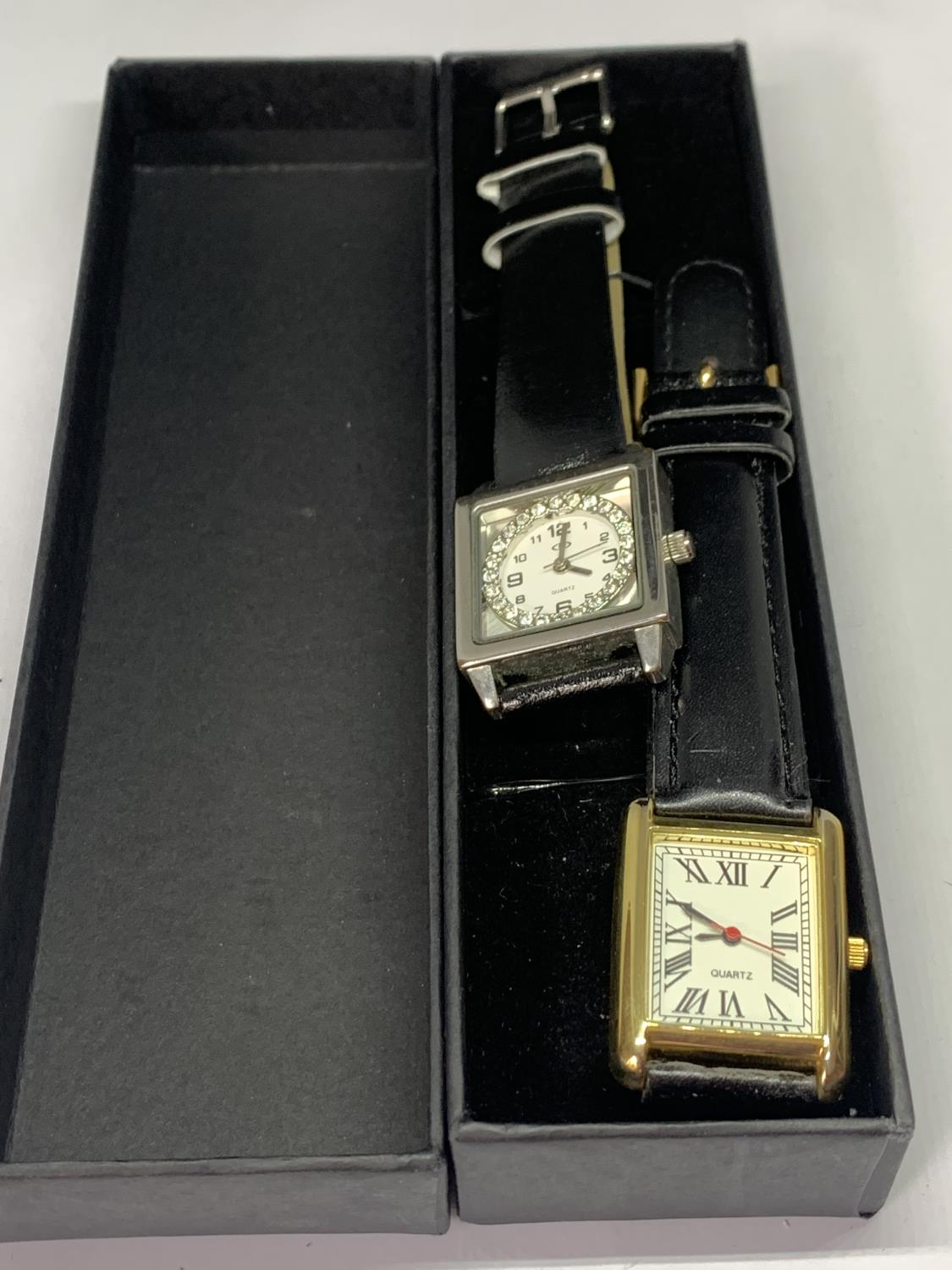 TWO WRISTWATCHES WITH BLACK LEATHER STRAPS