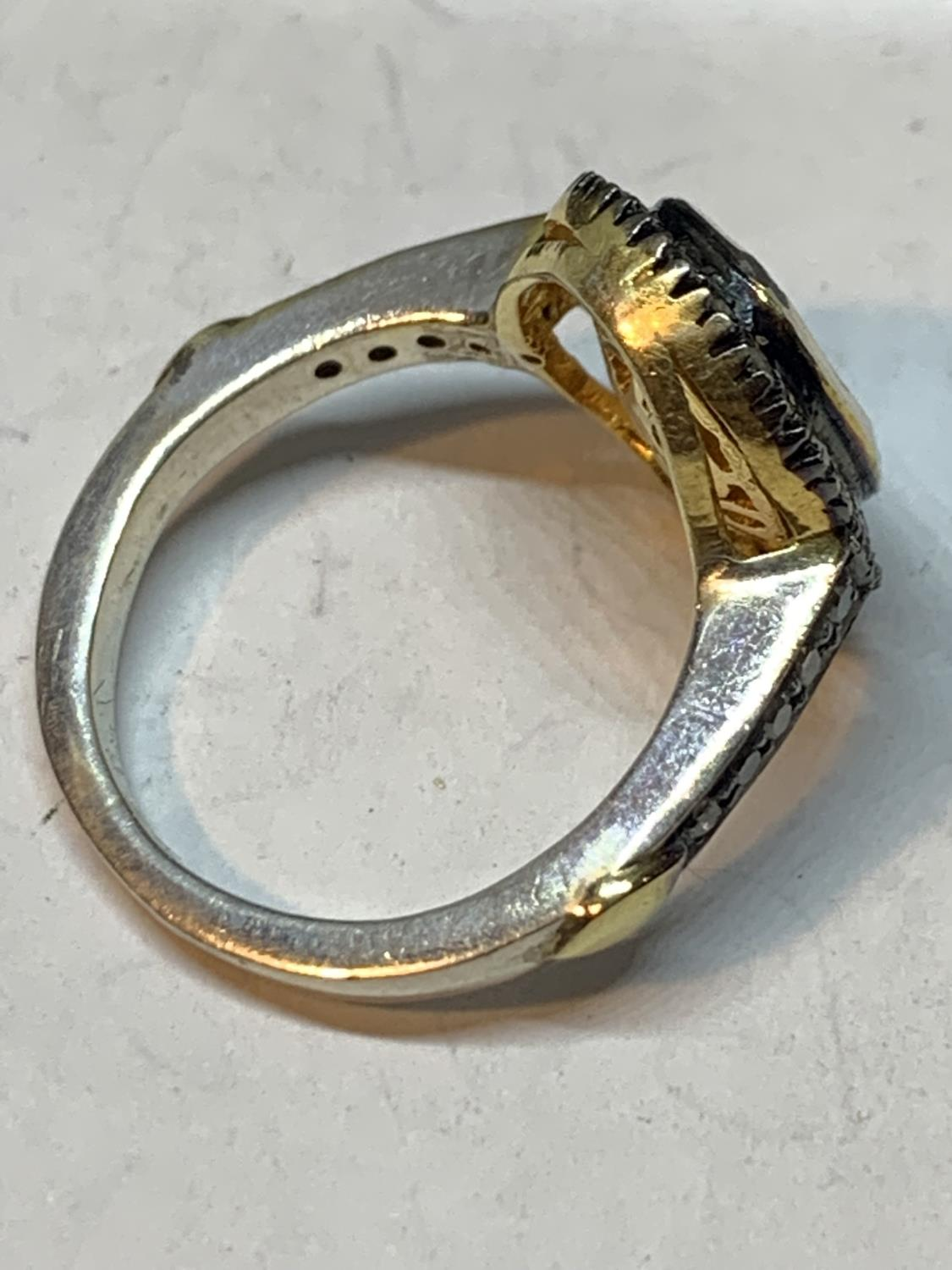A CONTINENTAL WHITE AND YELLOW METAL RING WITH CENTRE DIAMOND AND SMALLER SURROUNDING DIAMONDS WHICH - Image 3 of 6