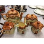 AN AFTERNOON TEA SET OF COUNTRY THATCHED COTTAGE WARE TO INCLUDE A TEA POT, LIDDED BUTTER DISH,