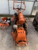 A HOWARD GEM PETROL ROTOVATOR WITH RIDGER, SPARE TYRES, BOX OF SPARES AND MANUAL. IN GOOD WORKING