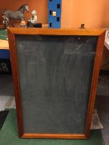 A WOODEN FRAMED COUNTER TOP DISPLAY CABINET