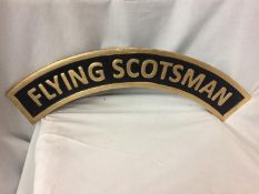 A CAST IRON FLYING SCOTSMAN SIGN