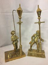 TWO BRASS FIGURES, ONE OF A STREETLAMP LIGHTER WITH DOG AND ONE OF A DRUNKEN MAN