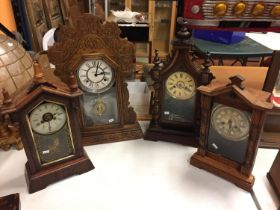 A VINTAGE AMERICAN GOTHIC STYLE CLOCK IN A WOODEN AND GLASS CASE WITH A BUTTERFLY PATTERN ON THE