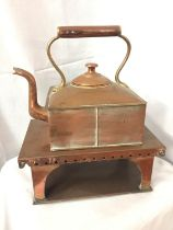 A SQUARE COPPER KETTLE TOGETHER WITH SQUARE STAND OVERALL HEIGHT 45CM, WIDTH 36CM