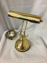 A BRASS BANKERS ADJUSTABLE DESK LAMP