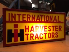 AN INTERNATIONAL HARVESTER TRACTORS ILLUMINATED LIGHT BOX SIGN