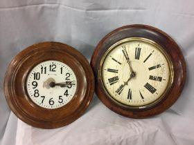 TWO CIRCULAR WOODEN FRAMED WALL CLOCKS