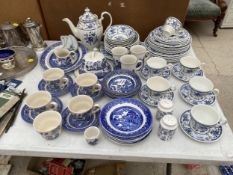 A LARGE ASSORTMENT OF BLUE AND WHITE CERAMIC WARE TO INCLUDE CUPS AND SAUCERS, PLATES, BOWLS AND A