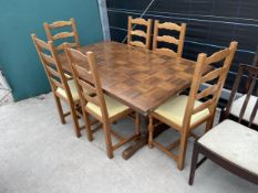 A REFECTORY STYLE DINING TABLE WITH WOODBLOCK TYPE TOP AND SIX LADDER BACK DINING CHAIRS
