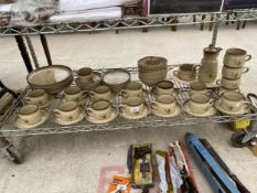 A PART COMPLETE DENBY DINNER SERVICE TO INCLUDE CUPS AND SAUCERS, SIDE PLATES, DESSERT BOWLS AND