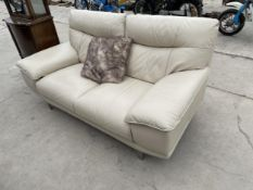 A MODERN WHITE LEATHER TWO SEATER SETTEE ON CHROME LEGS