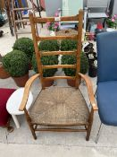 AN ARTS & CRAFTS STYLE BEECH RUSH SEATED LADDER BACK CHAIR