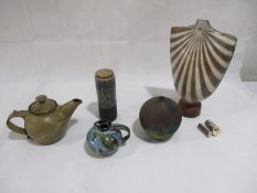A collection of studio pottery including a teapot, small jug, and usual bust shape vase A/F