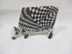 A Lawson E Rudge Raku pottery sculpture of a cow, numbered 52. Length approx. 35cm