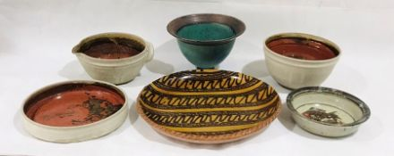 A collection of six pieces of studio pottery including a charger, dish, bowl etc