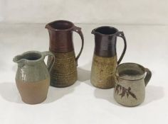 A collection of four studio pottery jugs
