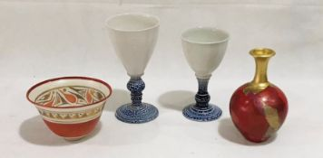 A collection of studio pottery including two goblets, vase and a bowl
