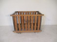 An industrial slatted bobbin trolley on wheels, 109 cm x 71 cm