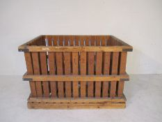 A large wooden slatted crate, 145cm x 106 cm