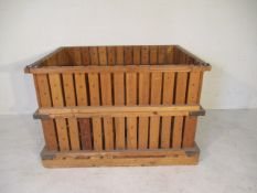A large slatted crate with drop down side, 143cm x 106cm x 94cm
