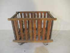 A slatted wooden bobbin trolley - length 110cm, width 70cm, missing a wheel